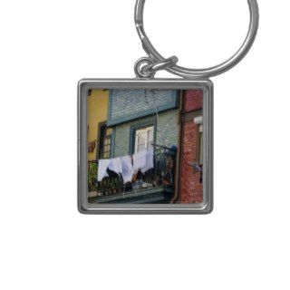 Portugal, Oporto (Porto). Woman hanging laundry Key Chain
