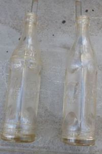Two Different Art Deco Style Embossed Big Chief Coca Cola Bottles 1 Muskogee OK
