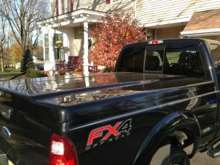 Leer 700 Tonneau Cover in Black Hard Fiberglass with Superlift System and Locks