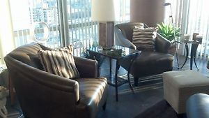 Pair of High End Leather Wing Chairs Selected by Nate Berkus Designer