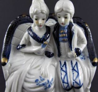 White Blue Hand Painted Figurine of Man Woman Sitting on Couch Home Decor